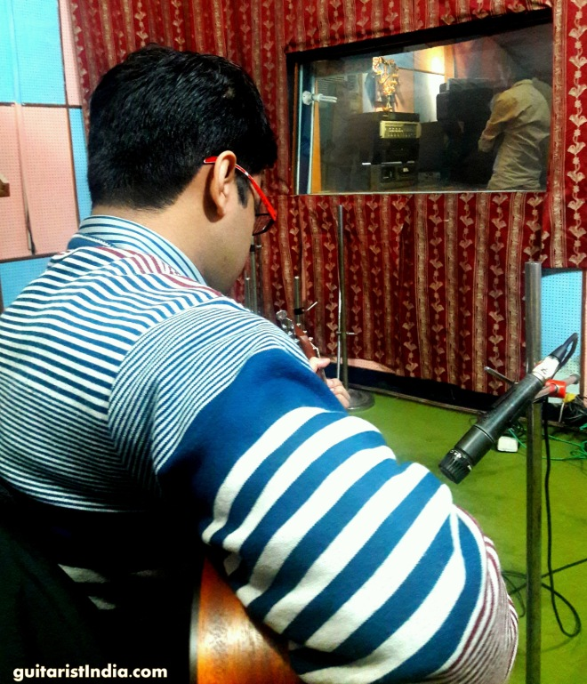 Kapil recording guitar at studio
